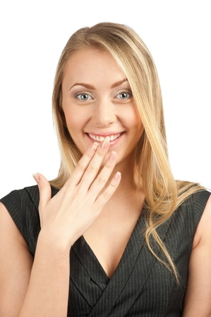 Portrait of surprised attractive businesswoman covering her mouth by the hands, over white background photo