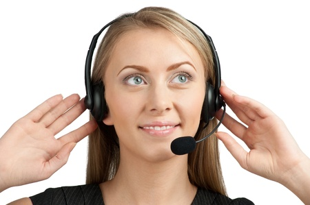 telephonist: Portrait of beautiful call center operator with headset. Isolated on white background