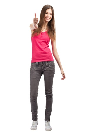 Full length portrait of a happy young woman standing and showing thumbs up, against white background Stock Photo - 10856007