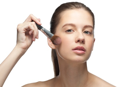 Close-up portrait of young beautiful woman applying makeup, isolated on white background Stock Photo - 10856053