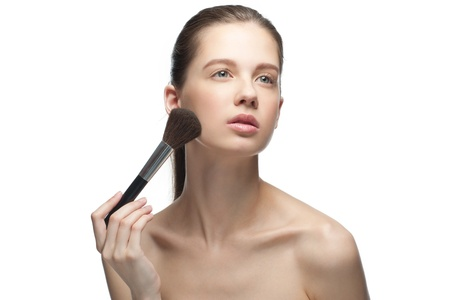Close-up portrait of young beautiful woman applying makeup, isolated on white background Stock Photo - 10856010