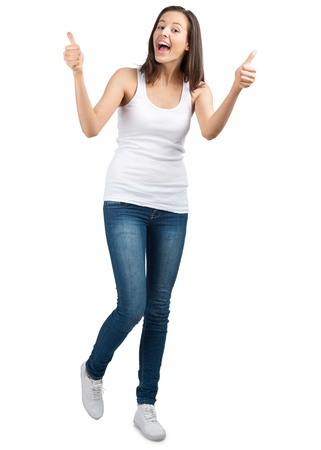 Full length portrait of a happy young woman laughing and showing thumbs up, against white background photo
