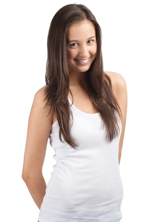 teen girl brown hair: Portrait of a happy young woman smiling and looking at camera, against white background