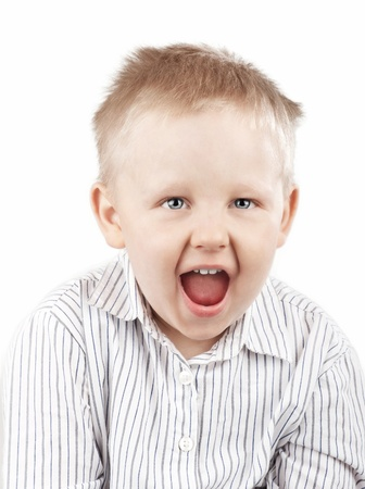 Little blond boy screaming, isolated on white photo