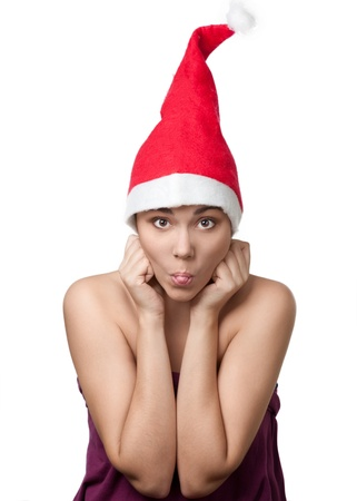 mrs claus: Funny portrait of pretty grimacing  woman wearing Santa hat against white background