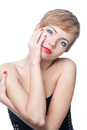 Portrait of  beautiful woman with red manicure against white background photo