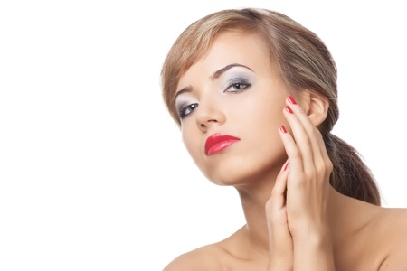 Portrait of  pretty young woman with red lipstick and manicure, against white background photo