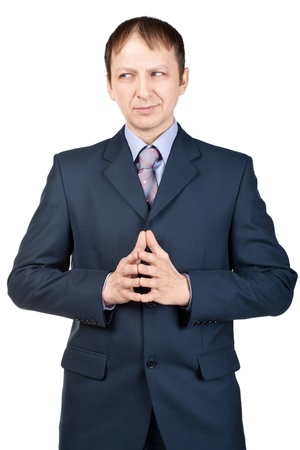 clasped: Portrait of a confident pensive businessman with clasped hands over white background