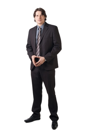 clasped: Portrait of a confident businessman with clasped hands over white background Stock Photo