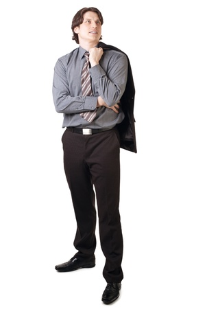 Handsome young businessman holding his jacket over his shoulder, over white background photo