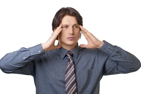 Handsome young businessman having a headache, isolated on white background Stock Photo