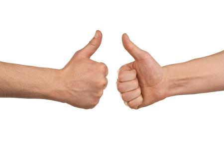 pulgar levantado: Dos manos de los hombres que muestran los pulgares para arriba signo contra el fondo blanco Foto de archivo