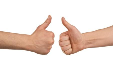 Two male hands showing thumbs up sign against white background photo