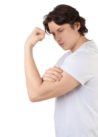 only the biceps: Handsome muscular young man measuring his biceps against white background
