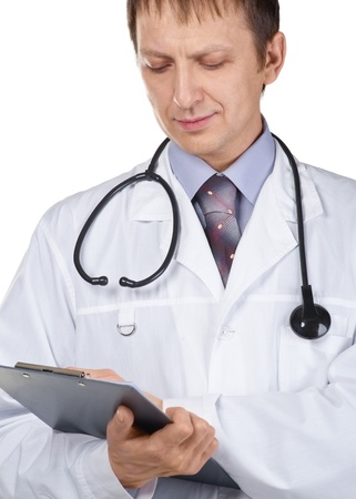 Portrait of handsome male doctor holding a writing pad against white background photo