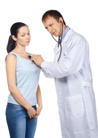 listening to heartbeat: Doctor listening the heartbeat of his patient with a stethoscope, over white background