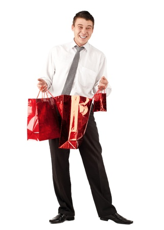man front view: Happy young businessman holding a shopping bags with gifts for Valentines Day Stock Photo