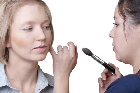 Professional make-up artist doing make-up using brush Stock Photo - 10947529