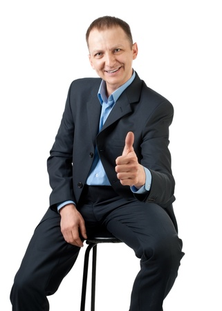 Confident businessman showing thumbs up sign and smiling, isolated on white Stock Photo - 10947443