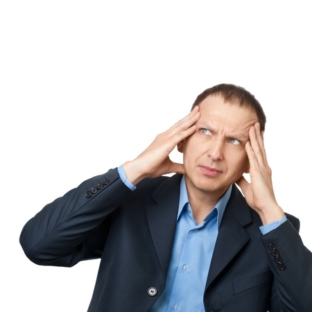 Worried businessman having a headache against white background photo