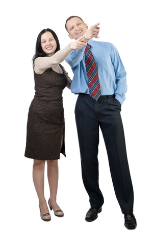 women and men: Two people smiling and pointing in the same direction, over white background Stock Photo