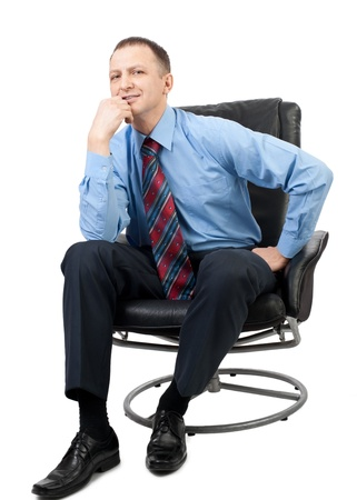 Portrait of a handsome businessman sitting in a armchair and  thinking, over white background photo