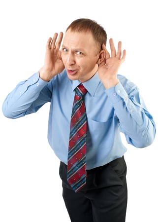 audible: Businessman cups hands to his ears to hear better, isolated on white
