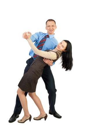 Happy young business couple dancing and laughing, against white background photo