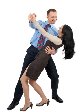 Happy business couple dancing and laughing, against white background photo