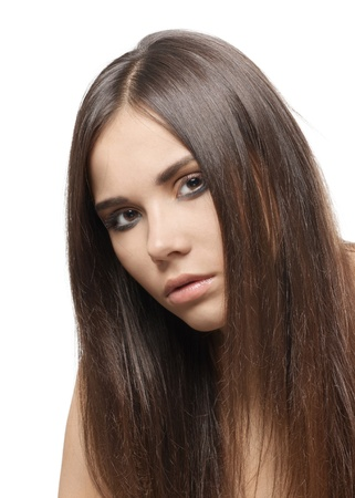 Closeup of a young beautiful woman with long brown hair over white background Stock Photo - 10947641