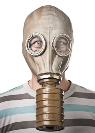 Man in gas mask looking surprised. Isolated on white photo
