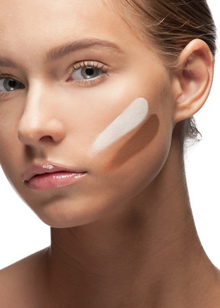 Close-up of beautiful young woman with stokes of foundation on her face Stock Photo - 10947912