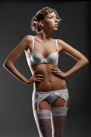 Portrait of a sensual bride wearing white lingerie photo