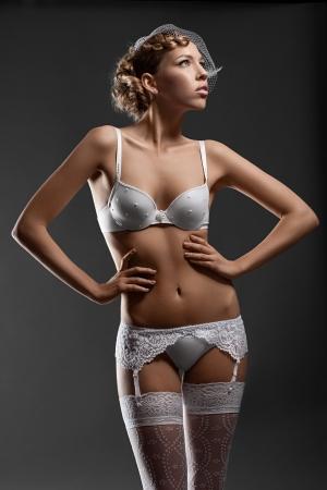 Portrait of a sensual bride wearing white lingerie Stock Photo - 10947930