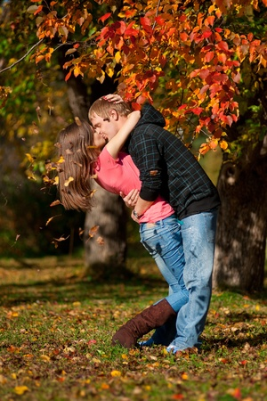 love kiss: Young beautiful couple kissing in autumn park