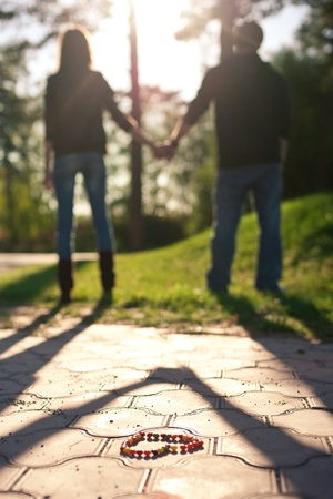 green back: Image of a young couple holding hands, outdoors