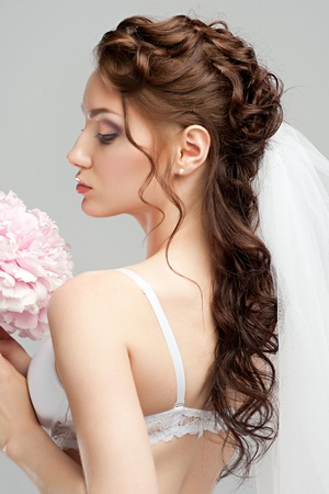 Portrait of a beautiful bride with pink bridal bouquet photo