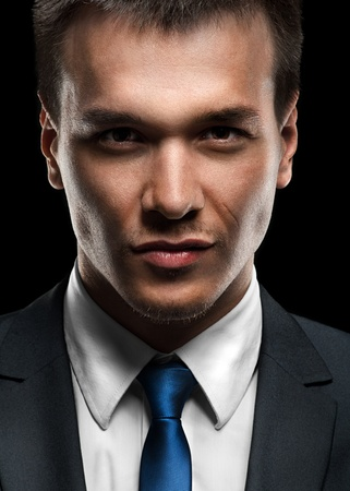 Close-up portrait of handsome business man looking at camera photo