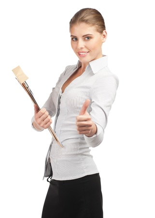 successfull: Portrait of confident young business woman with documents showing thumbs up and smiling, isolated on white background