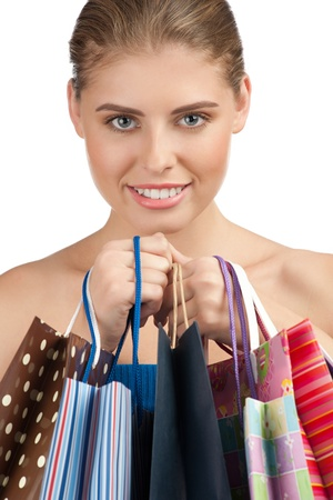 Portrait of lovely young woman with colorful shopping bags in her hands Stock Photo - 10947851