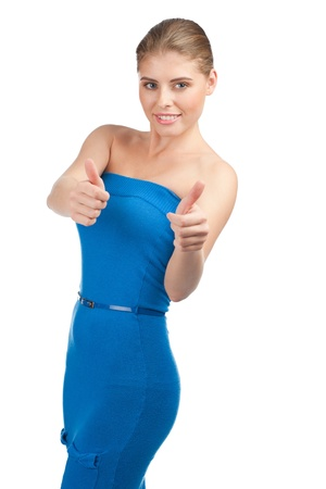 Attractive young woman showing thumbs up and smiling, against white background Stock Photo - 10947798
