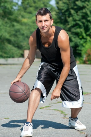 basketball player: Portrait of male basketball player playing outdoors