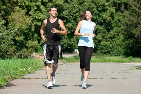 Young fitness couple of man and woman jogging in park Stock Photo - 10947894