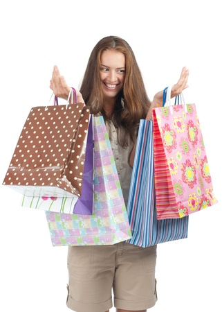shopaholics: Young beautiful  woman with colorful shopping bags in her hands Stock Photo