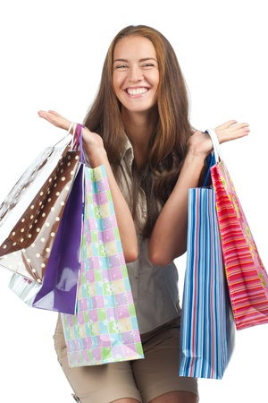 Excited woman with colorful shopping bags in her hands photo