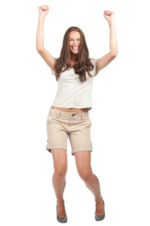 enthusiasm: Full length portrait of happy excited woman celebrating her success. Over white background