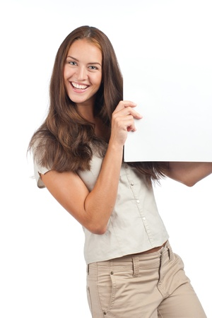 Smiling young woman holding a blank billboard, isolated on white background photo