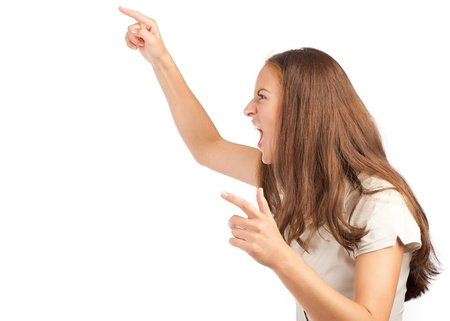 Portrait of angry young woman screaming and pointing. Isolated on white background