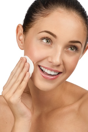 Portrait of young beautiful woman with cotton swab cleaning her face Stock Photo - 10947023