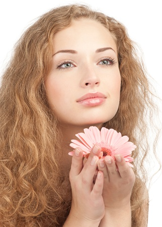 Close-up portrait of young beautiful woman with long curly hair holding pink flower. Isolated on white background Stock Photo - 10948025
